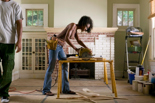 African American couple renovating home interior.