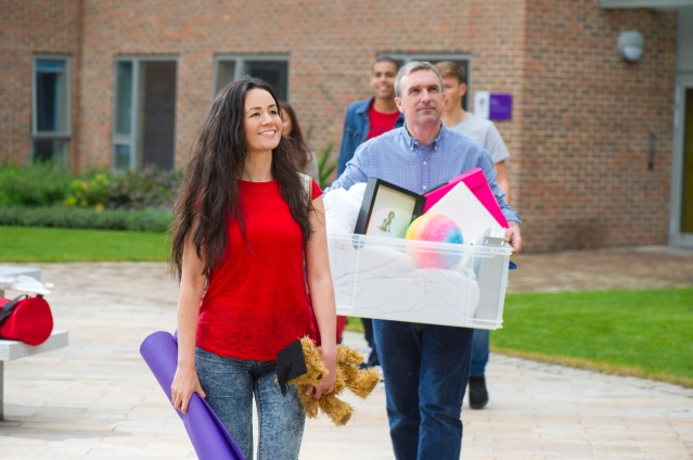 Dad helping daughter move into University